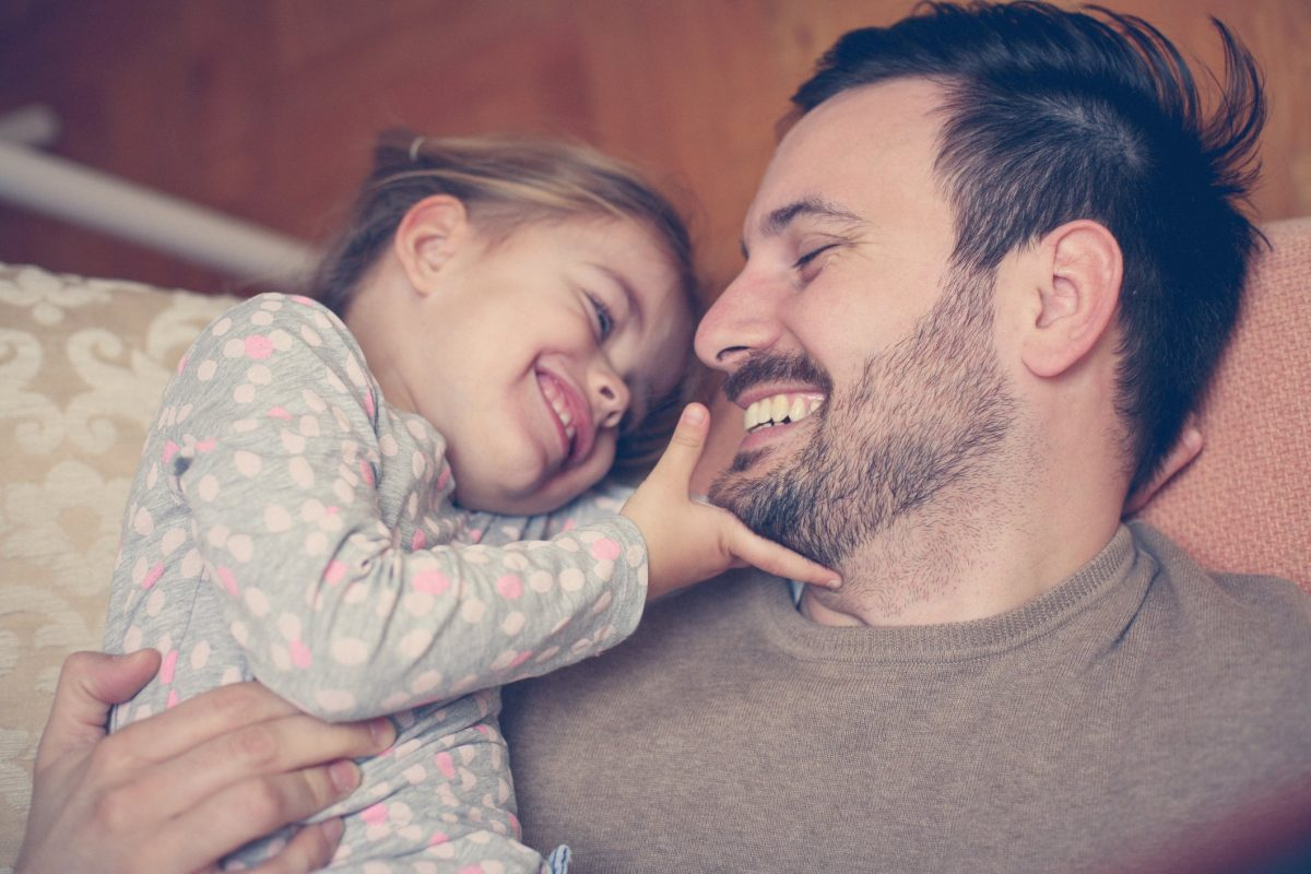 Father with his daughter spending time at home.